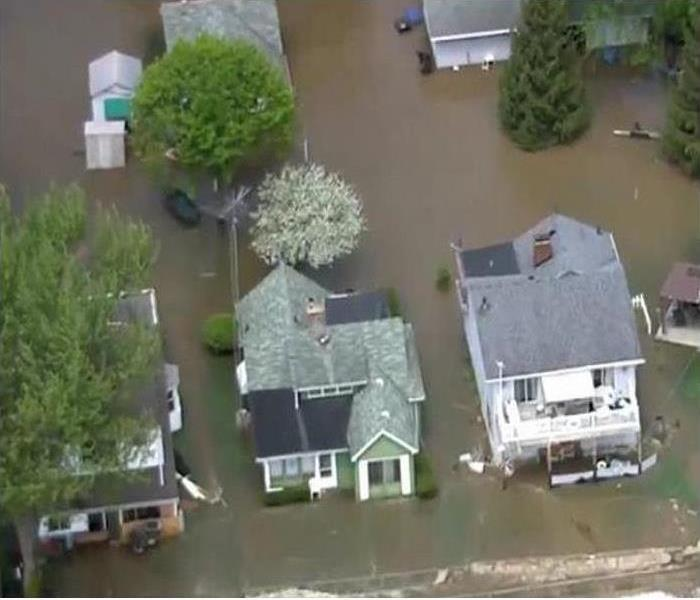Bird eye view of major flooding surround Metro Detroit homes